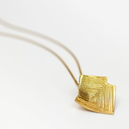 Lines in Motion Gold Pendant