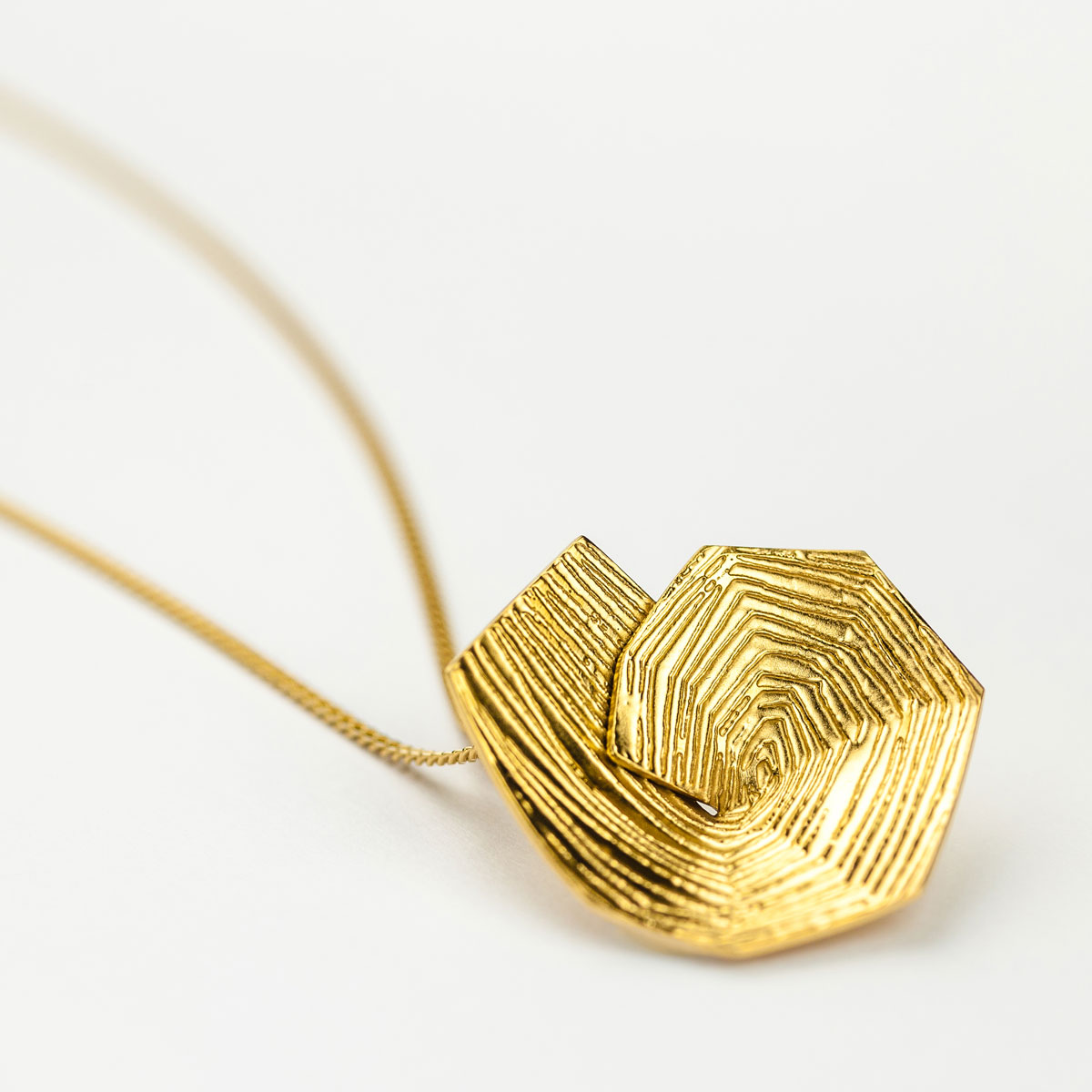 'Lines in Motion' Spiral Gold Pendant